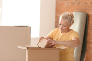 Divorced woman packing up for home sale