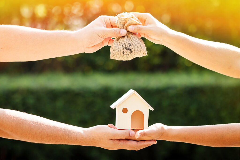 People exchanging house for money, metaphor for home prices