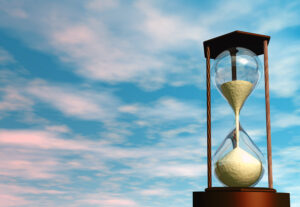 Hourglass in the sky, representing waiting in a competitive real estate market