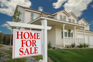 Home sitting for sale, representing real estate market pause