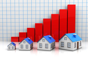 Chart and houses for real estate market update.