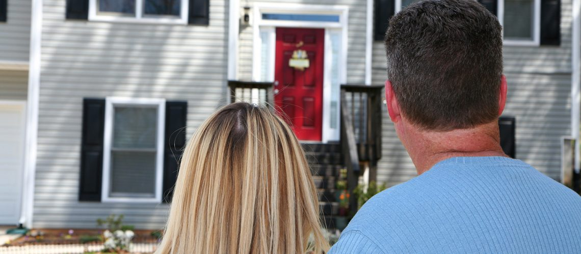 Home buyers looking at house for sale